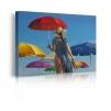 Quadro donna con ombrello al mare prospettiva